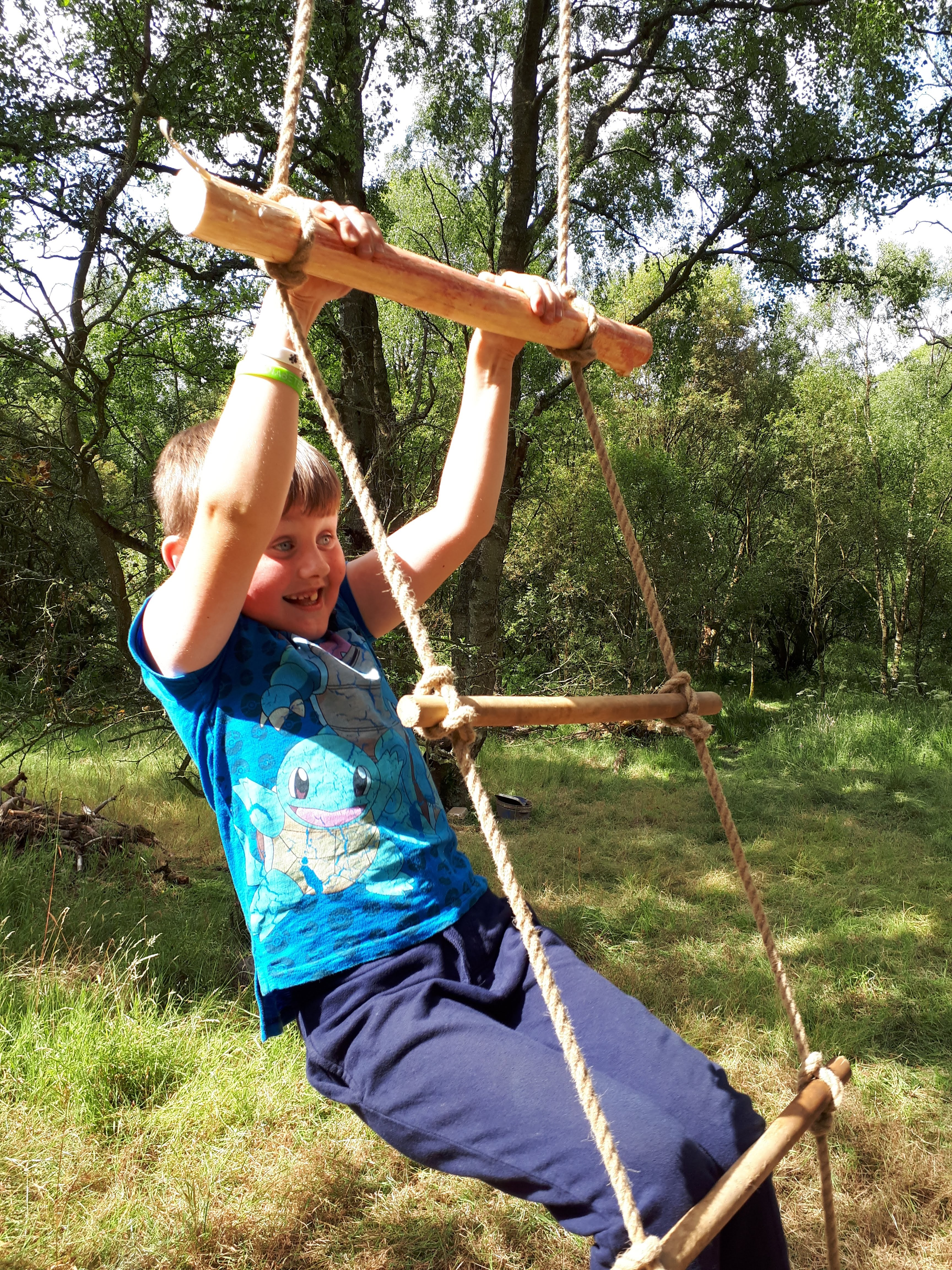 Boy on a rope ladder