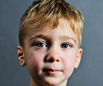 Portrait of child with blue eyes and blo