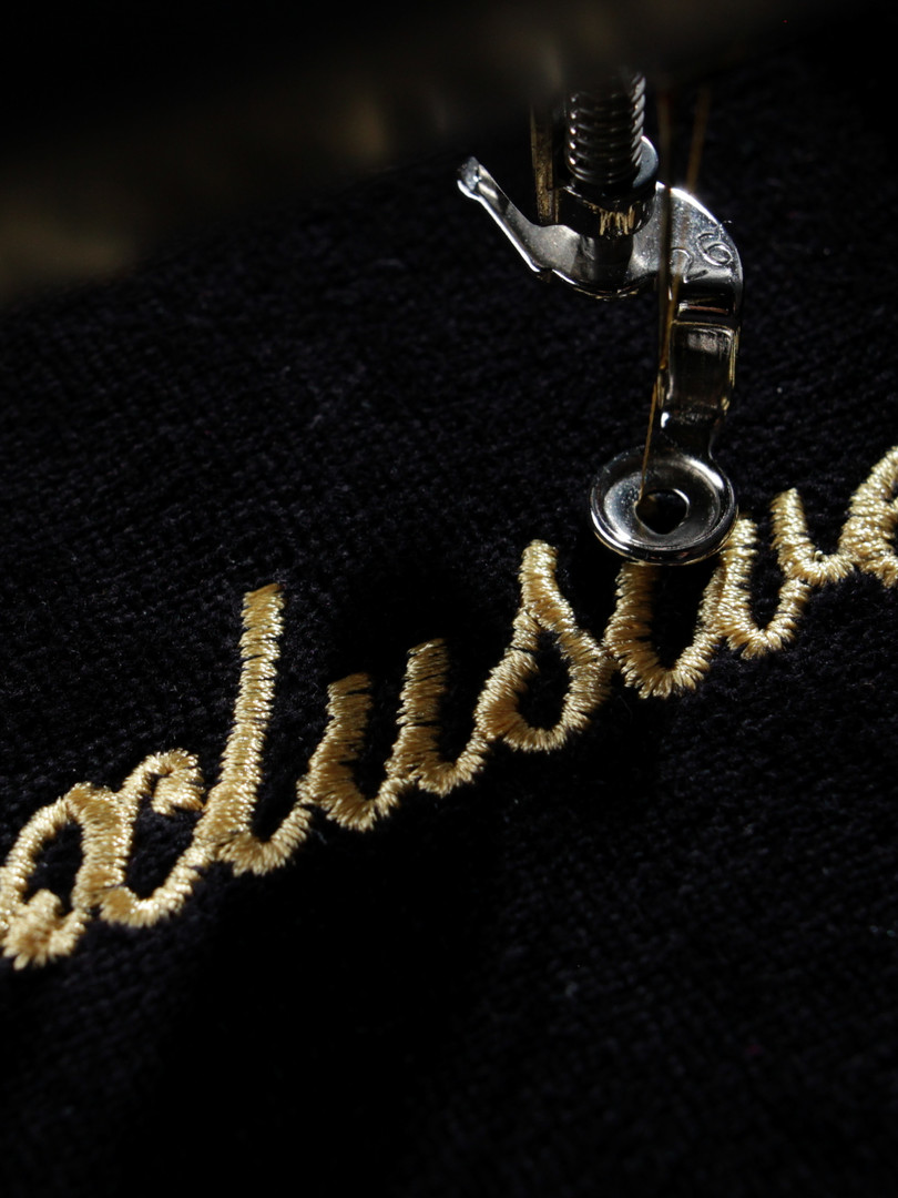 embroidery of gold lettering _exclusive_
