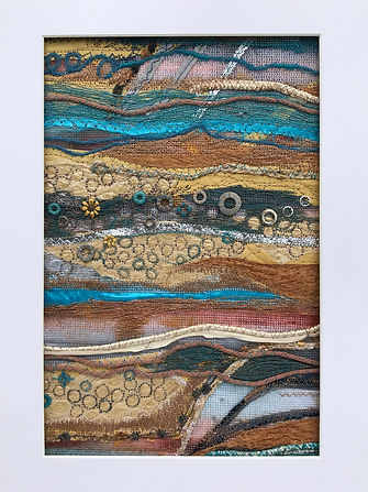 Machine embroidered artwork in rust colours with texture