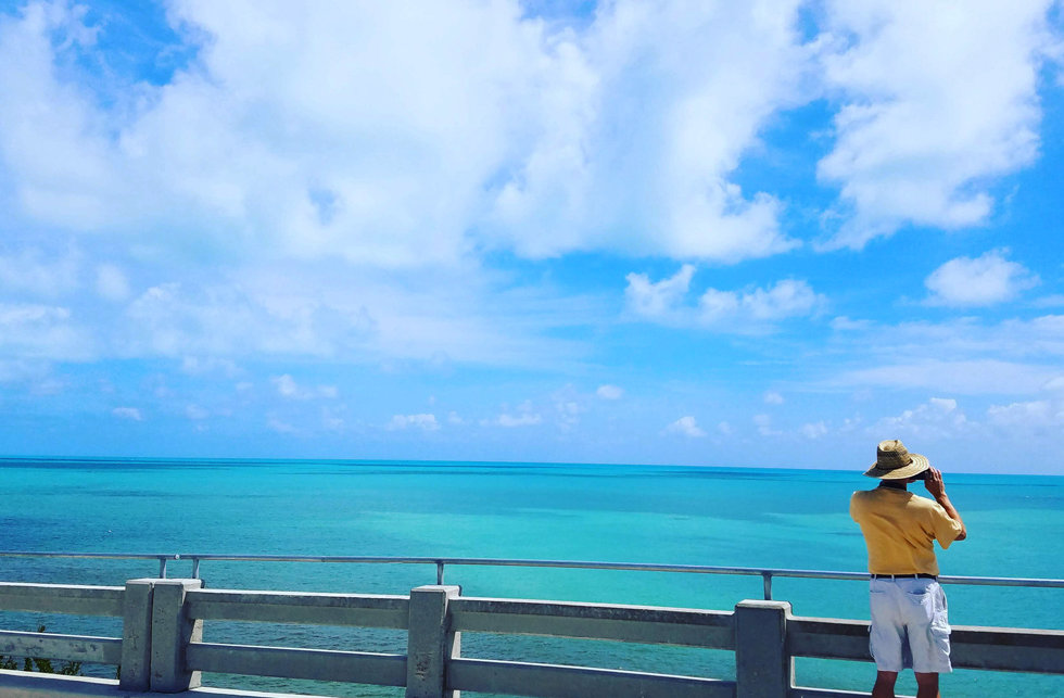 Tour Guest on a Bridge in the Florida Keys looking at the Spectacular View