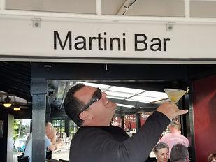 Man holding a martini at a martini bar on a Pub Crawl in Key West