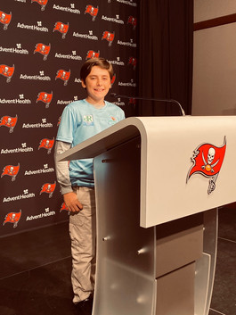 Zach at the Podium