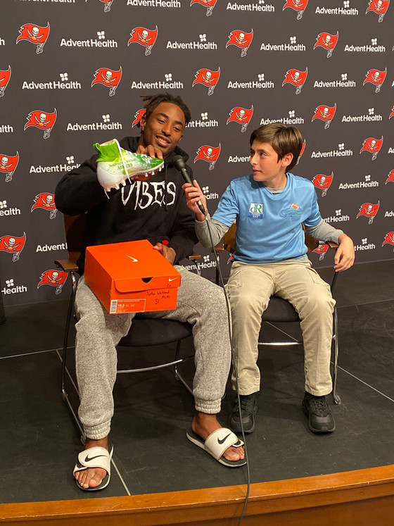 Zach with the Bucs on unboxing day