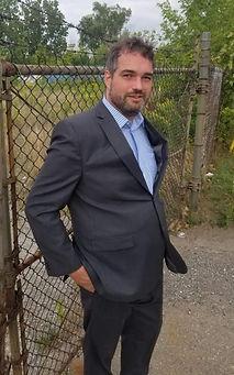 John Davies wearing a suit. No tie.