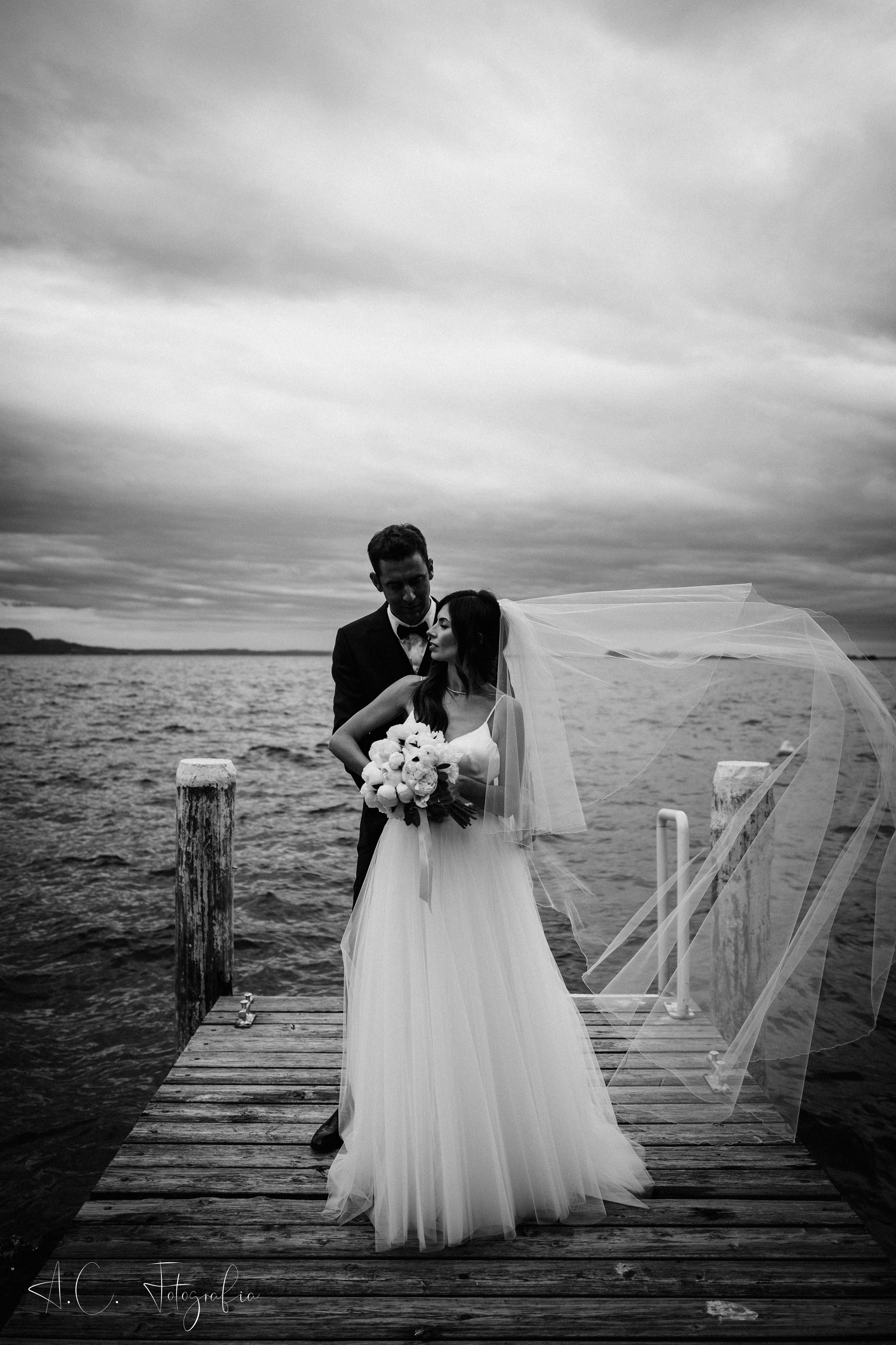 Bride and Groom in love on Garda lake