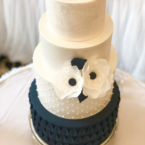 Navy and ivory wedding cake