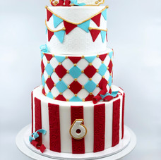 Circus Cake with Gold Embellishments