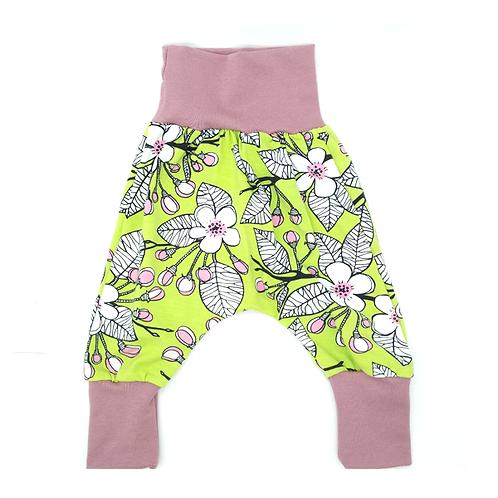 Pantalon évolutif vert pomme fleurs blanches