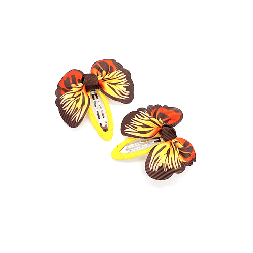 Lot de 2 barrettes papillon jaune/marron