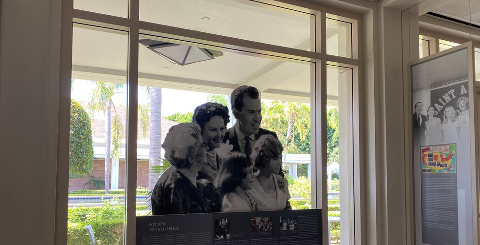 cut out window graphic in the title ix exhibit featuring richard nixon and family