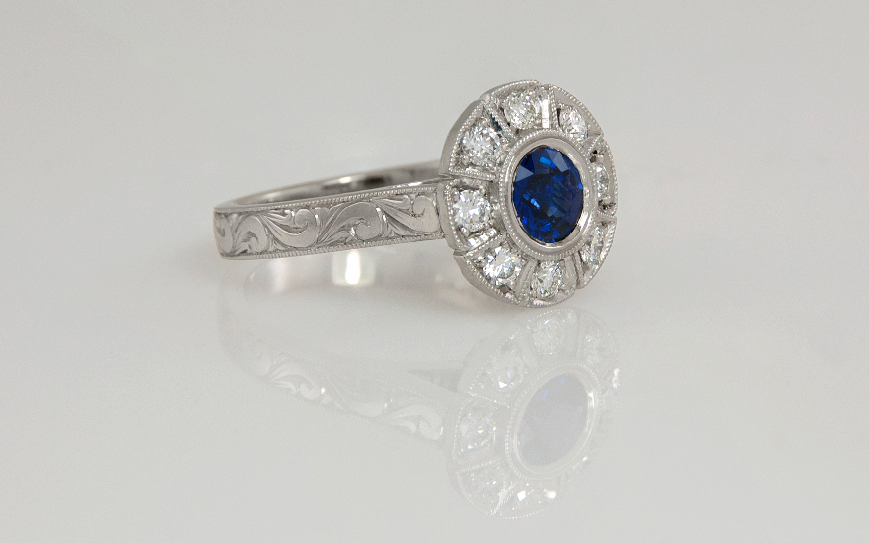 Platinum Hand Engraved Sapphire and Diamond Engagement Ring