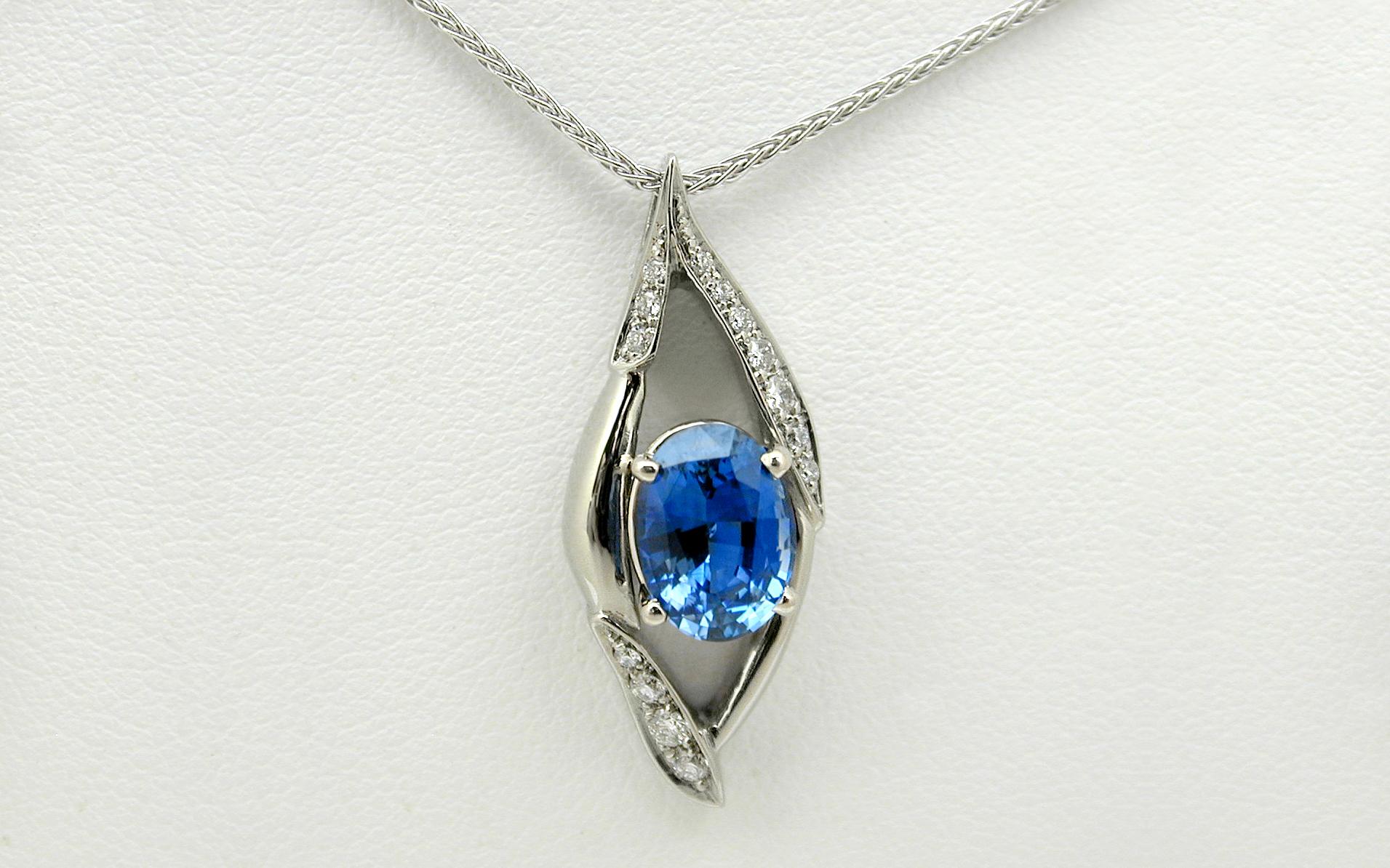 2.16 carat Oval Sapphire & Bead Set Diamond