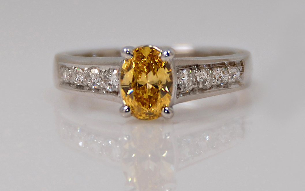 Oval .60 carat Natural Fancy Yellow with Bead Set Diamond Band