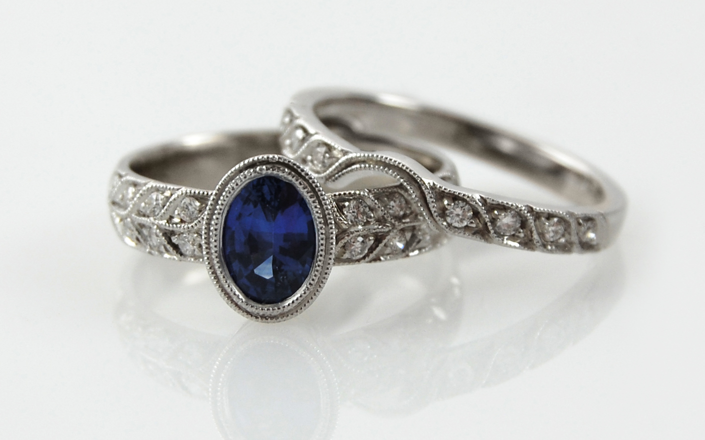 Oval Sapphire with Double Row Bead Set Diamonds