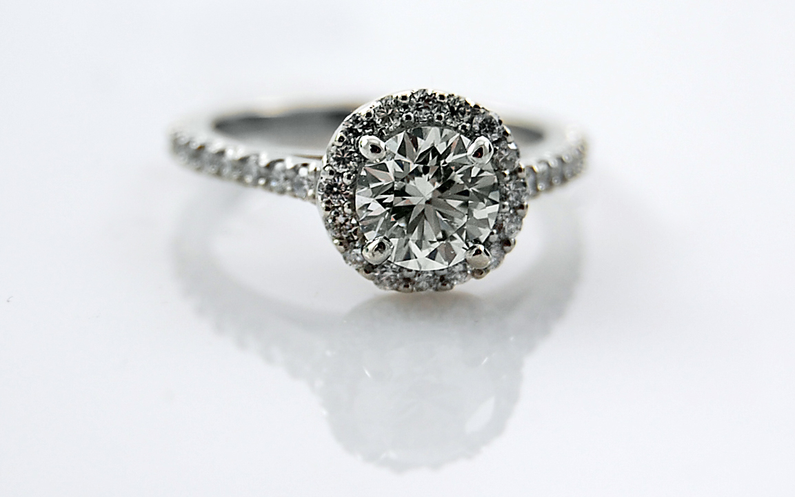 Delicate Halo with .90 carat Center