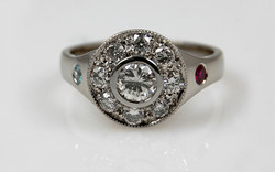 Halo with .45 carat Center & Flush Set Birthstones in Band