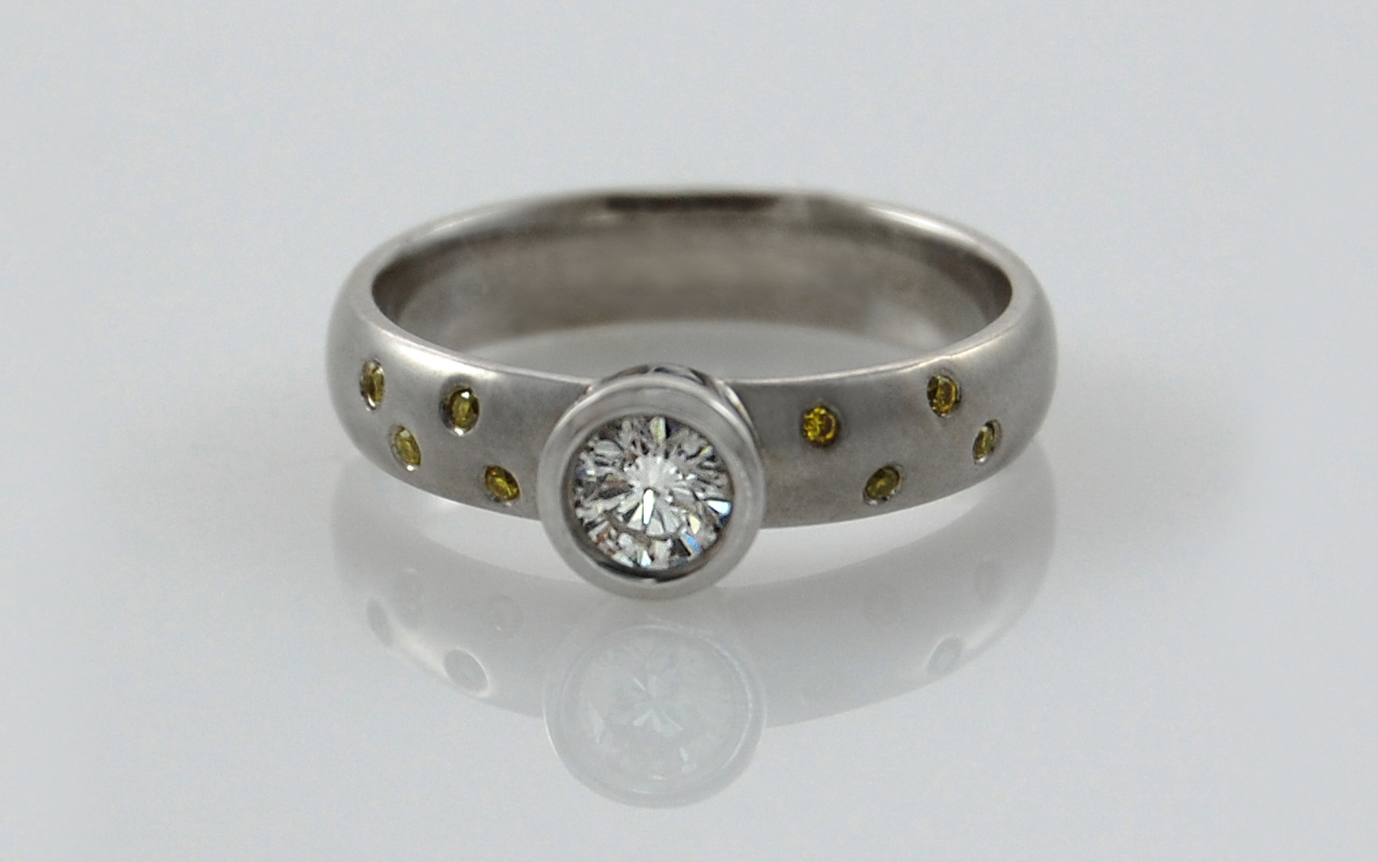 Bezel Set .30 carat with Flush Set Natural Fancy Yellow Diamonds