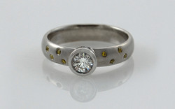 Bezel Set .30 carat with Flush Set Natural Fancy Yellow Diamonds