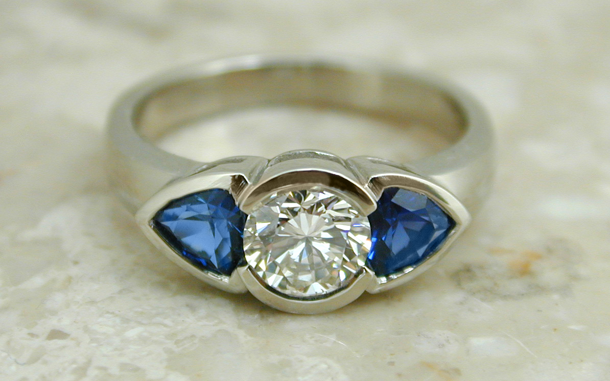Bezel Set .70 carat with Trillion Cut Sapphires