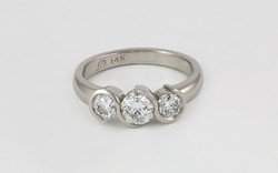 3 Stone Swirl Bezel Diamond Ring