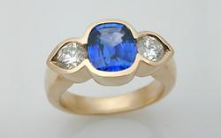 Cushion Cut Sapphire 3 Stone Bezel