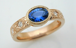 Hand Engraved Oval Sapphire with Diamond Accents