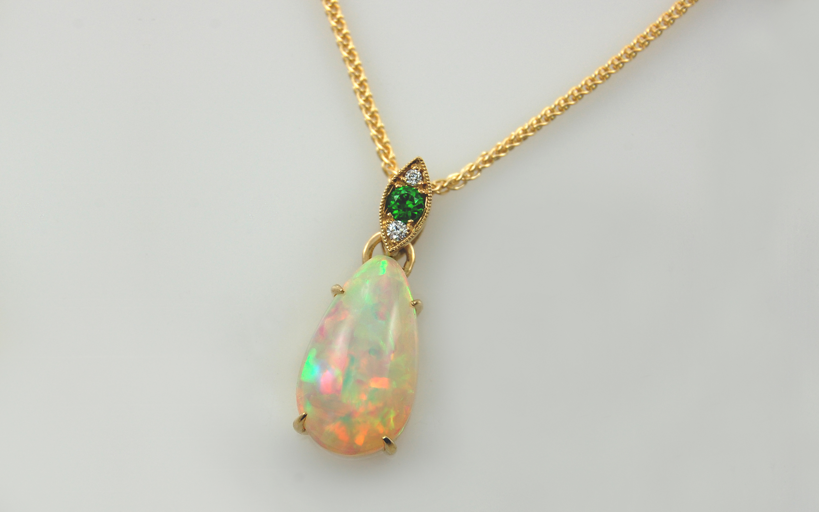 Pear Shaped Ethiopian Opal & Demantoid Garnet