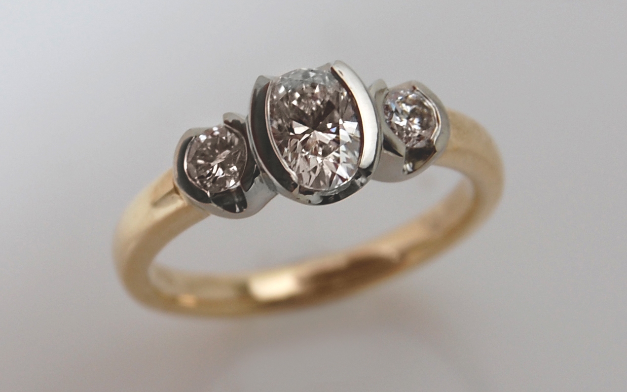 Two Tone Semi Bezel with .58 carat Oval Center