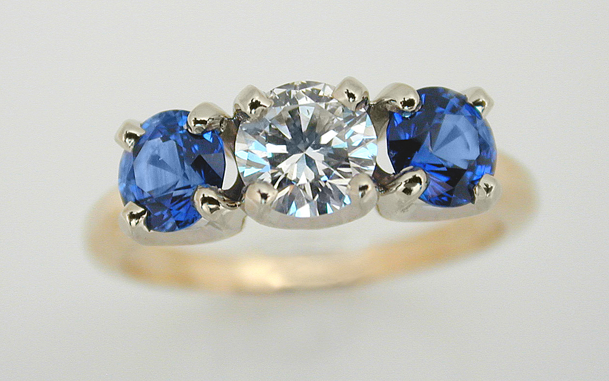 Two Tone 3 Stone with .58 carat Diamond & Sapphires