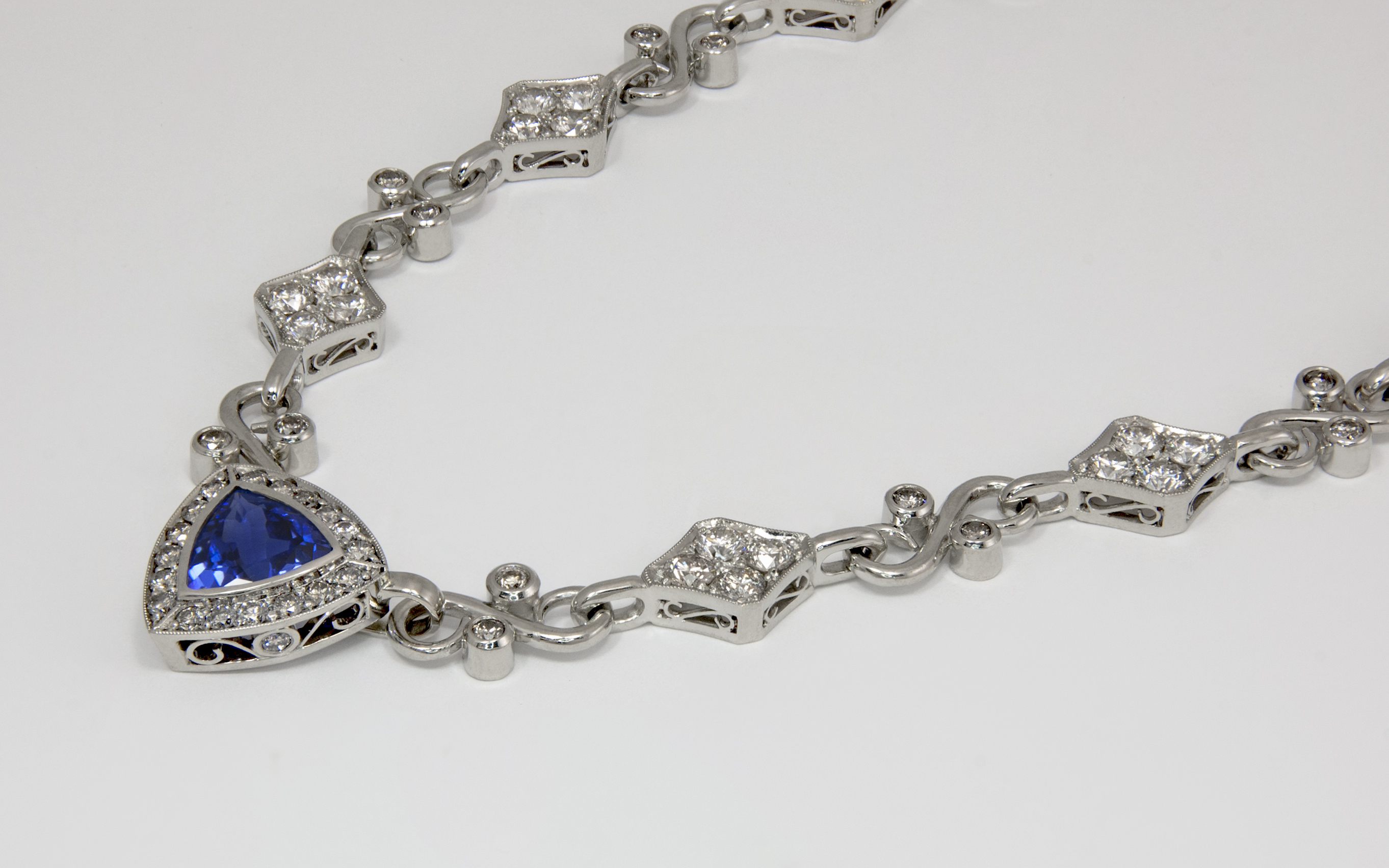 14KW Diamond and Trillion Cut Tanzanite Necklace