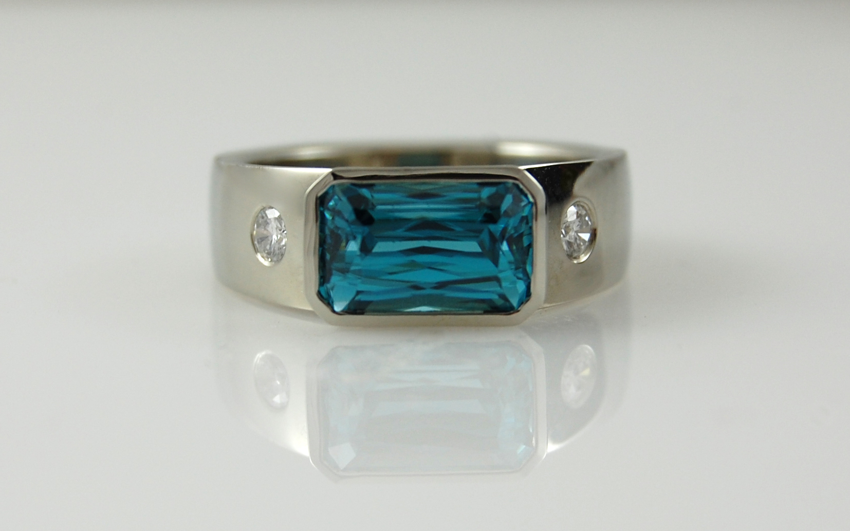Blue Zircon with Flush Set Diamonds