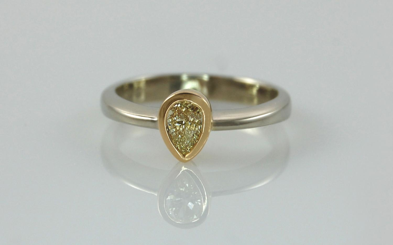 Two Tone .28 carat Natural Fancy Yellow Pear Shaped Diamond Bezel