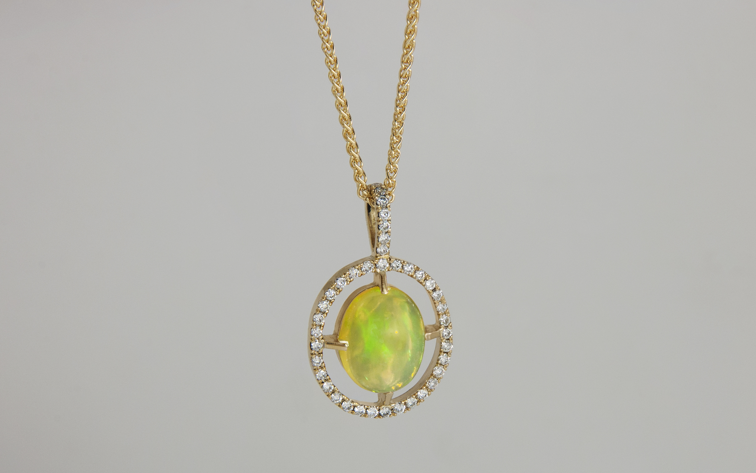 Ethiopian Opal and Diamond Halo Pendant