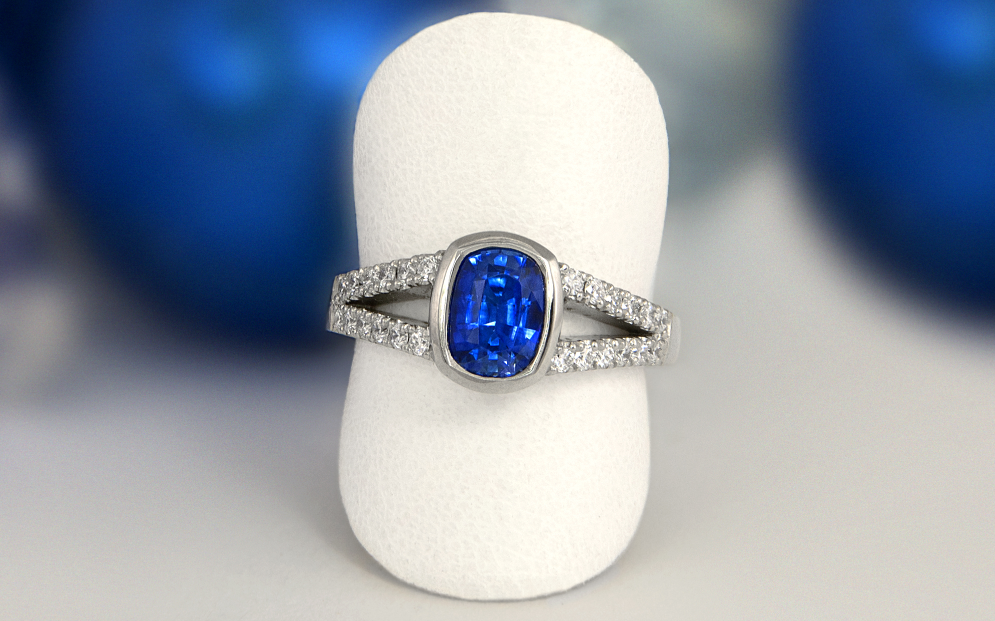 Split Shank Cushion Cut Sapphire and Diamond Ring