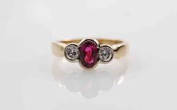 Oval Ruby & Diamond Bezel