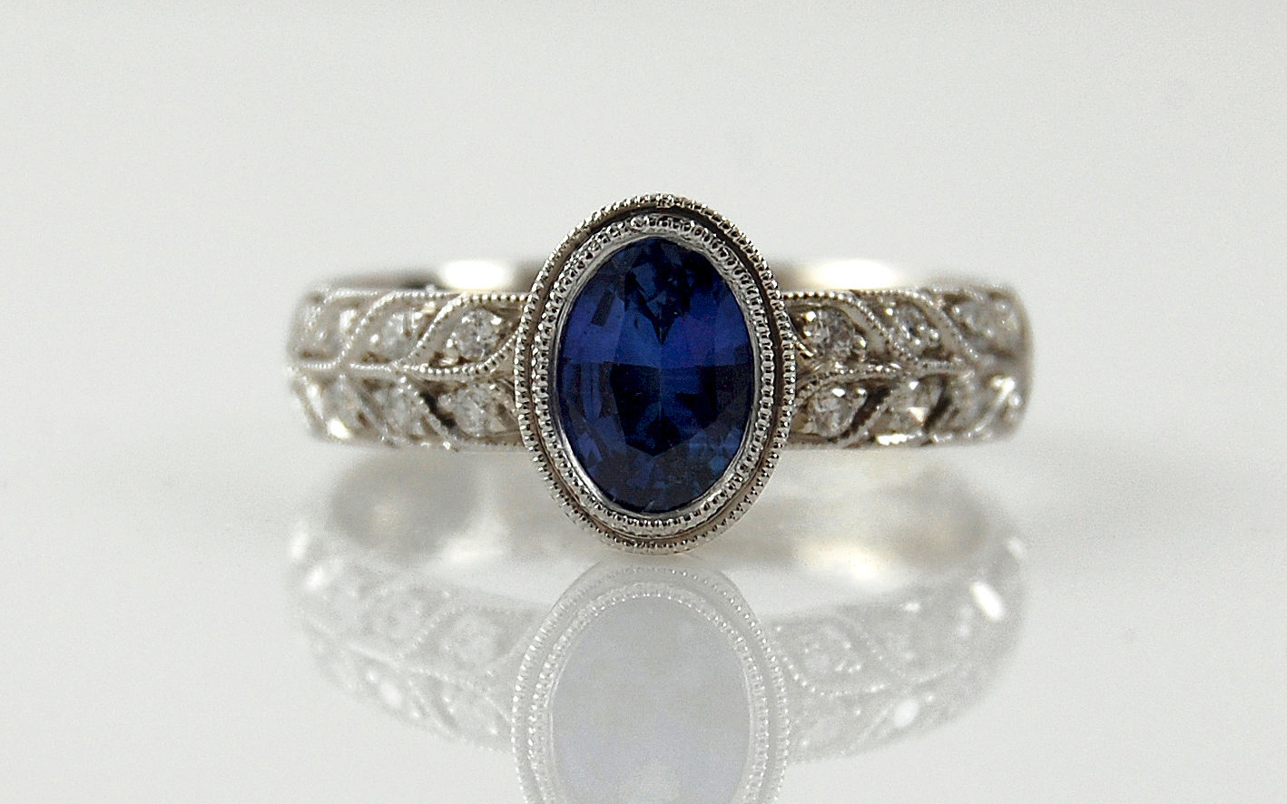 Oval Sapphire with Double Row Bead Set Diamonds