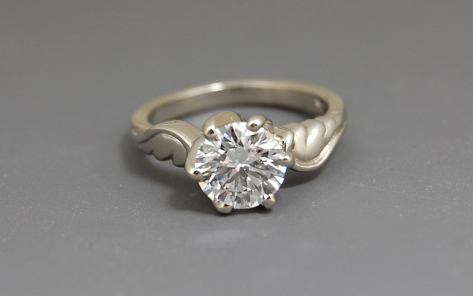 1.30 carat Diamond Solitaire with Wing Motif