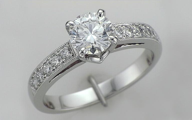 Hand Fabricated Platinum .90 carat with Bead Set Band