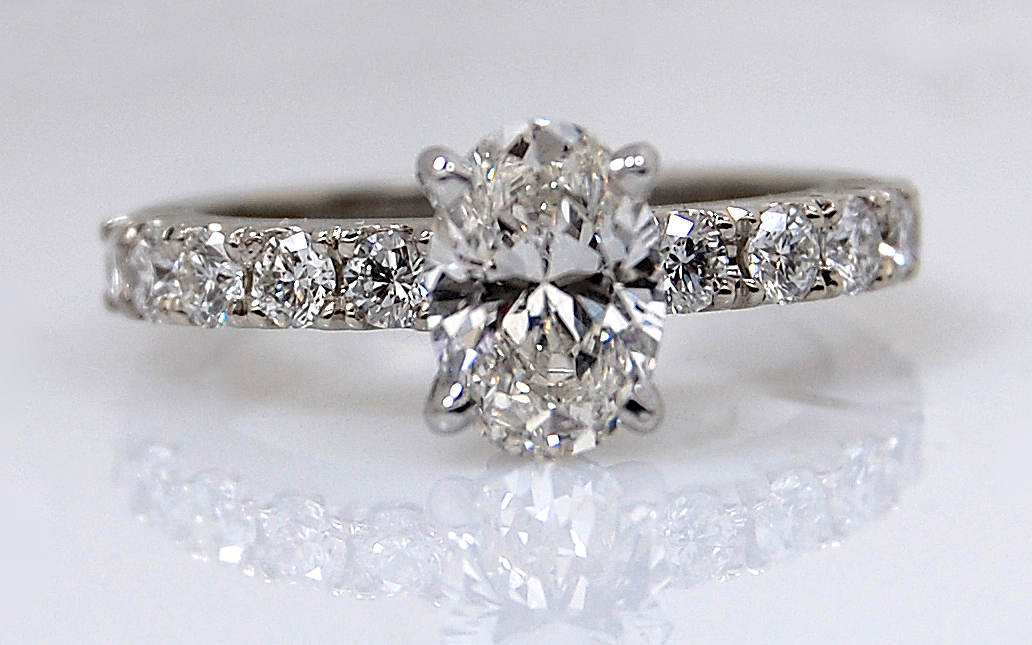 1 carat Oval with Diamonds French Cut in Band