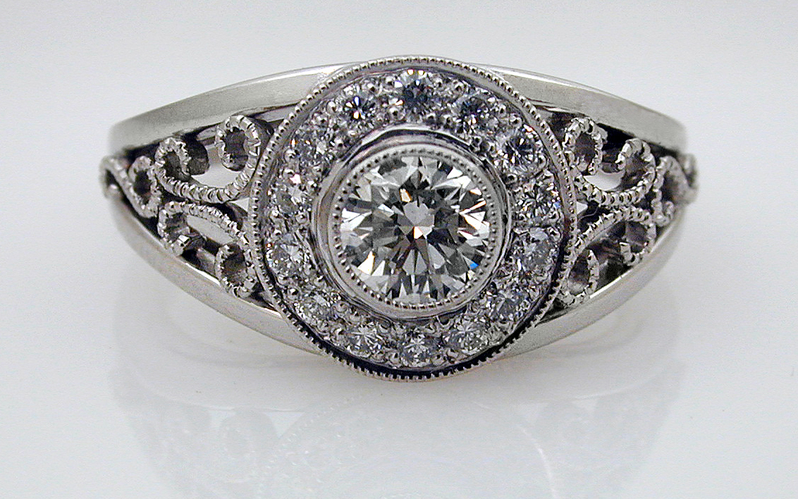 Diamond Halo with .48 carat Center & Hand Fabricated Accents