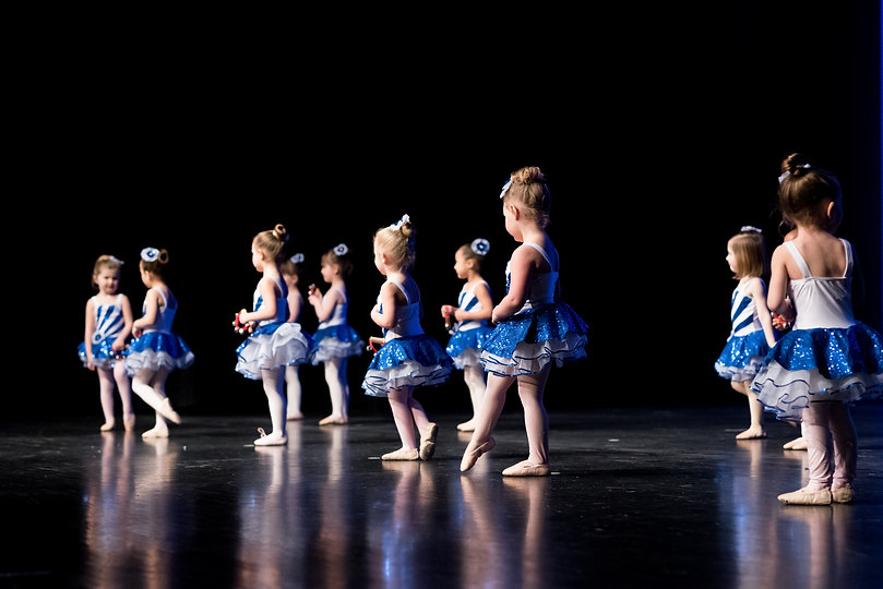 dancers-in-blue-costumes-on-stage