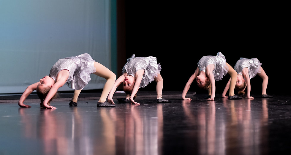 dancers-in-back-bends-on-stage
