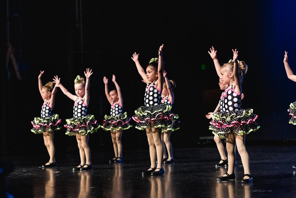 tap-dancers-raising-arms