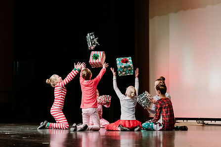 dancers-on-stage-tossing-presents