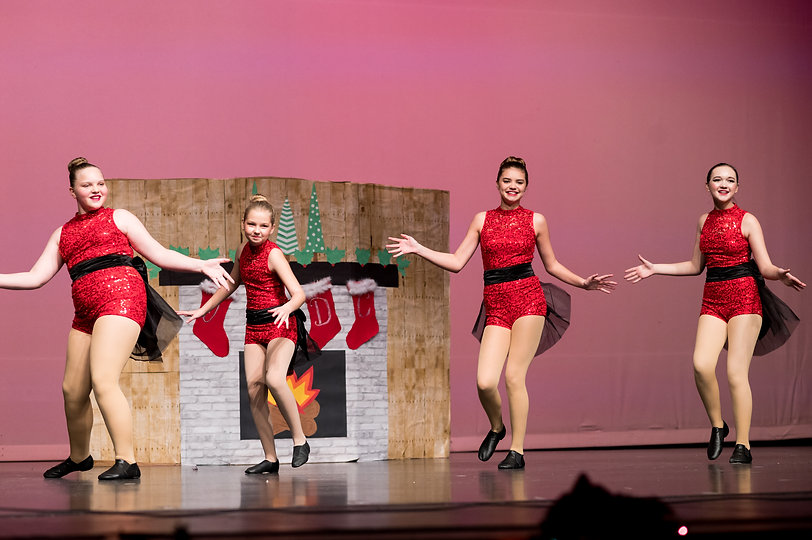 dancers-in-holiday-show-wearing-red