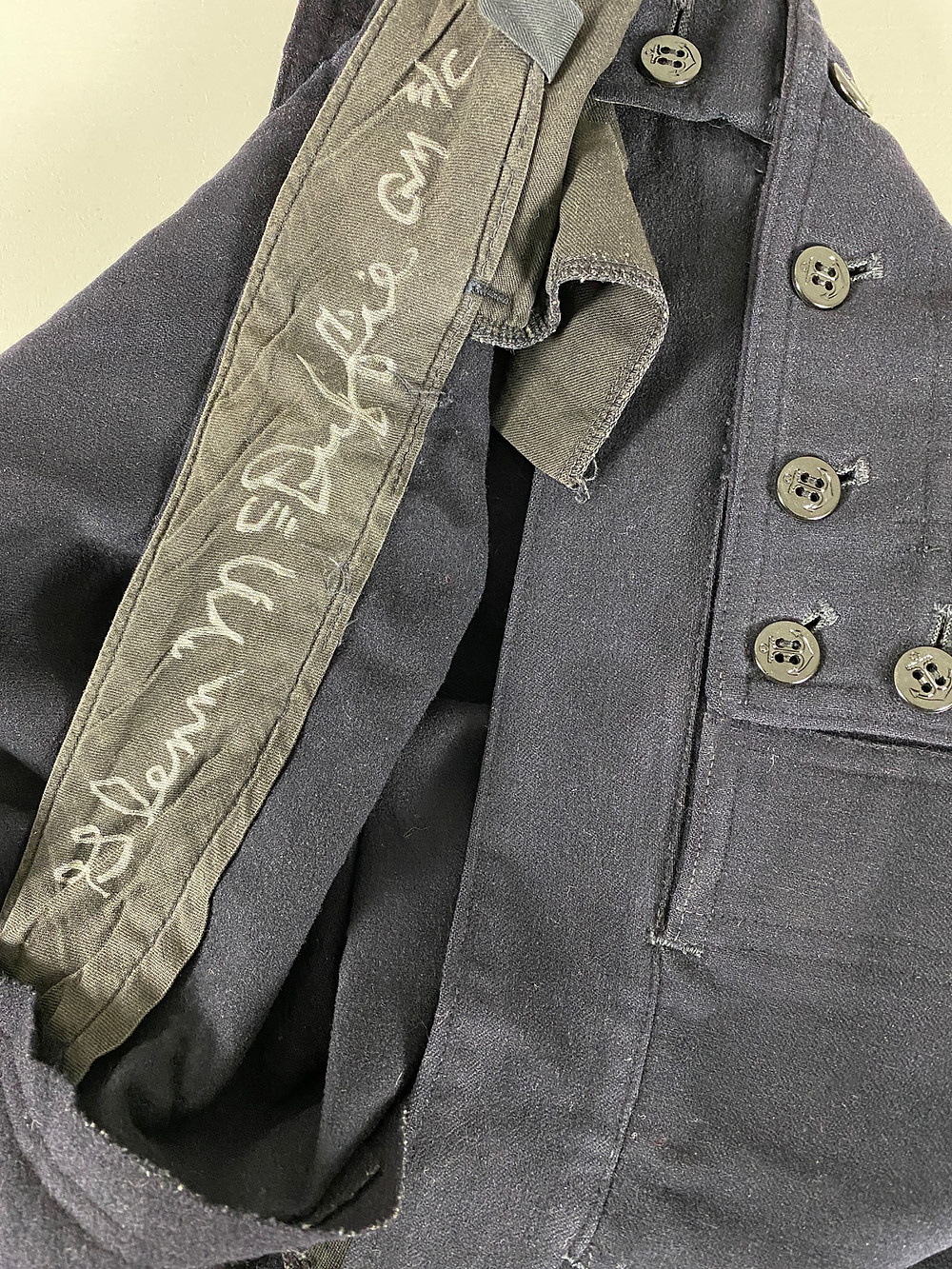 McDuffie also signed the waistband of the pants of his sailor uniform.