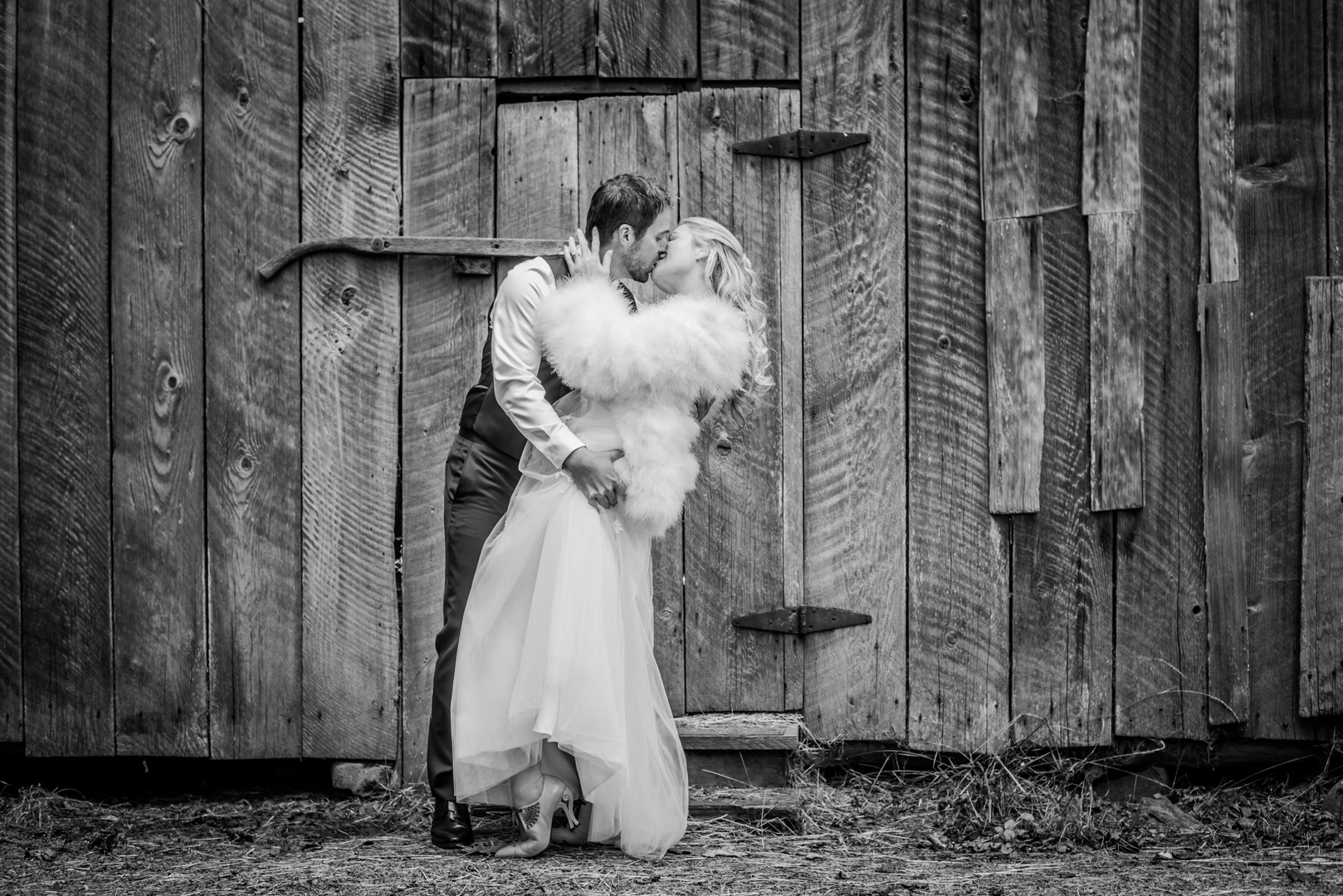 Bride and groom with barn