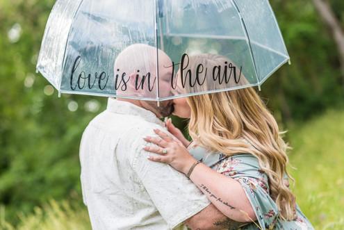 couple kissing under umbrella