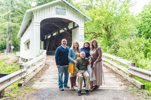 family photo at covered bridge